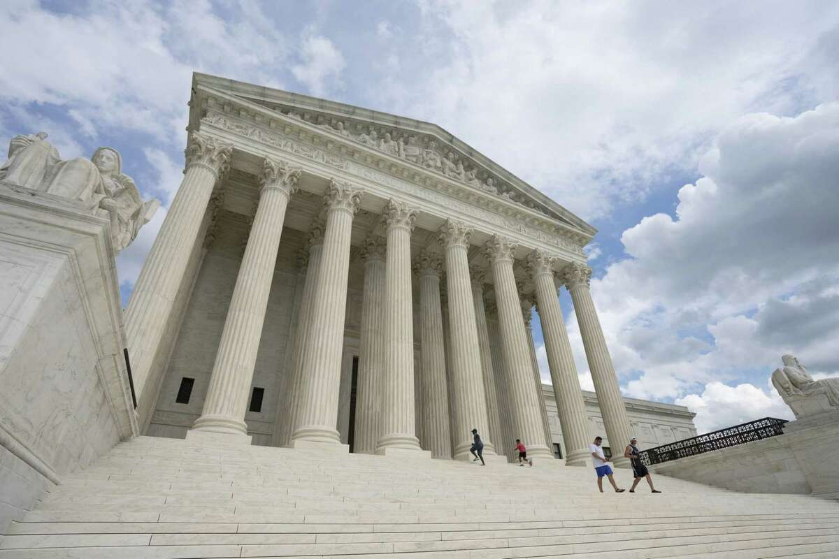 Visitors walk the steps of the U.S. Supreme Court in Washington on Aug. 1, 2020.