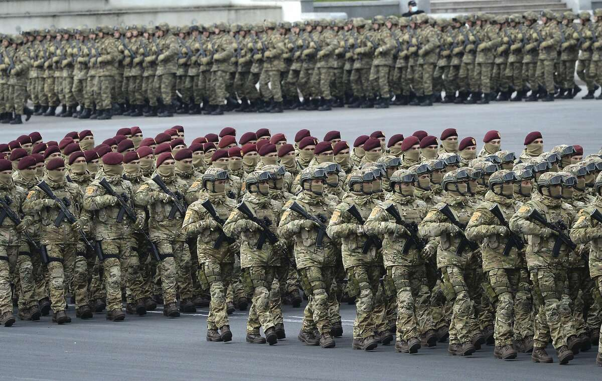 Azerbaijani troops march during a December parade in Baku, Azerbaijan, to celebrate a peace deal with Armenia over Nagorno-Karabakh that saw Azerbaijan reclaim much of the separatist region.