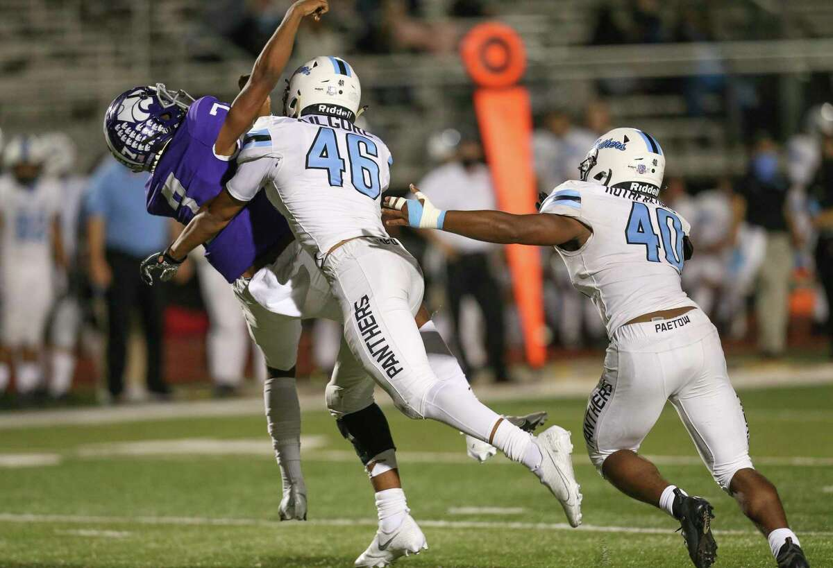 Angleton Wildcats quarterback Adrian Ewells (7) throws an interception as he is hit by Paetow Panthers linebacker Alex Kilgore (46) in the fourth quarter on November 20, 2020 at Angleton Wildcat Stadium in Angleton, TX.