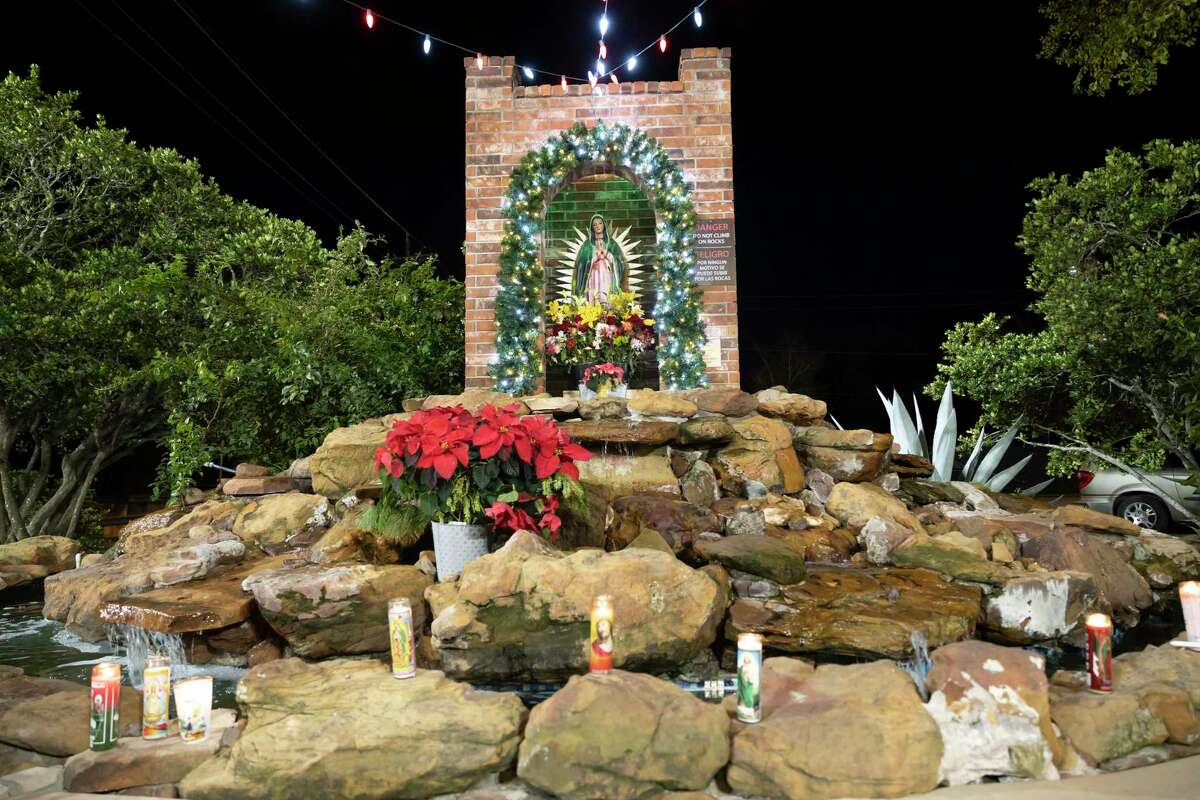 As seen, a state of La Virgin de Guadalupe sits at the grotto near Sacred Heart Catholic Church, Wednesday, Dec. 9, 2020, in Conroe. Congregants adopted COVID-19 safety measures for their annual feast to Our Lady of Guadalupe.