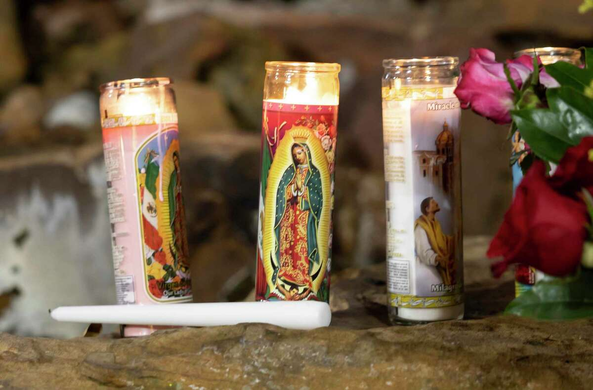 Candles are lit at the grotto to the Virgin of Guadalupe near Sacred Heart Catholic Church, Wednesday, Dec. 9, 2020, in Conroe. Congregants adopted COVID-19 safety measures for their annual feast to Our Lady of Guadalupe.