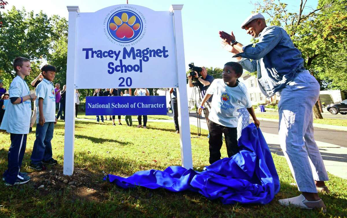 Students and faculty unveil the new sign as Tracey Elementary School holds its official Character Education Magnet Kick-Off Celebration on Friday, September 27, 2019, in Norwalk, Conn. T