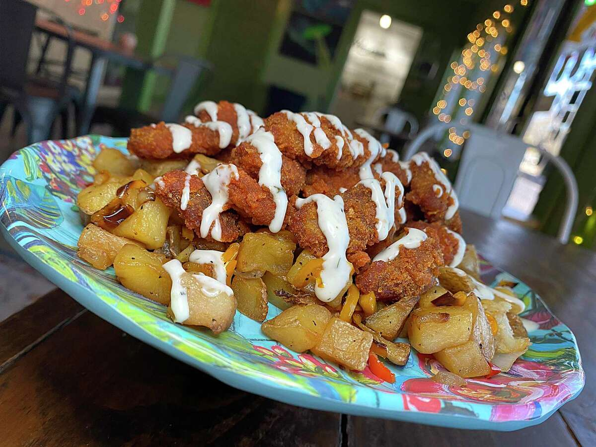 Buffalo Hash includes vegan fried chicken nuggets in spicy buffalo sauce, fried potatoes, onions and tangy ranch-style sauce at Hash Vegan Eats on South Flores Street.