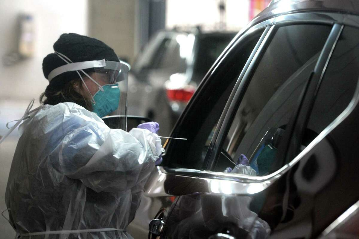 Medical personnel conduct daily drive-thru COVID-19 testing at Bridgeport Hospital.