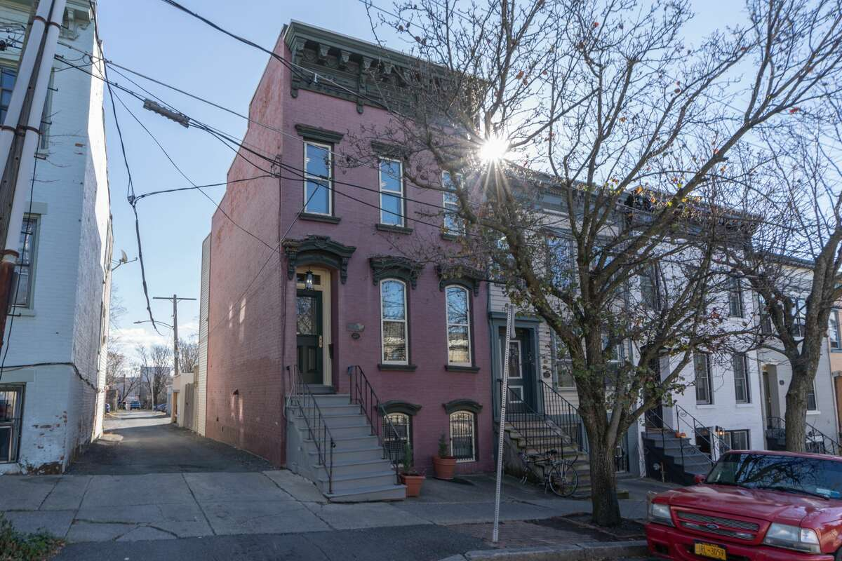 A downtown townhouse this week in Albany's Mansion District. Built in 1871, the three-story home at 173 Eagle St., Albany, is divided into an owner's unit and a garden-level apartment. Taxes: $5,130. List price: $219,000. Contact listing agent Julia Rosen of Berkshire Hathaway HomeServices Blake at 518-859-7725. https://realestate.timesunion.com/listings/173-Eagle-St-Albany-NY-12202-MLS-202033678/47445722