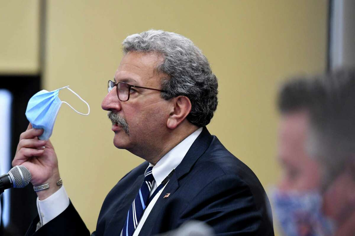 Dr. Ferdinand Venditti, Albany Medical Center executive vice president for system care delivery & hospital general director, urges proper use of face masks during the Thursday, Dec. 10, 2020, Albany County coronavirus briefing with Albany County Executive Dan McCoy, right, at the county office building in Albany, N.Y. The county reported an increase of 208 new positive cases since Wednesday. Two deaths and 13 new hospitalizations were reported overnight. (Will Waldron/Times Union)