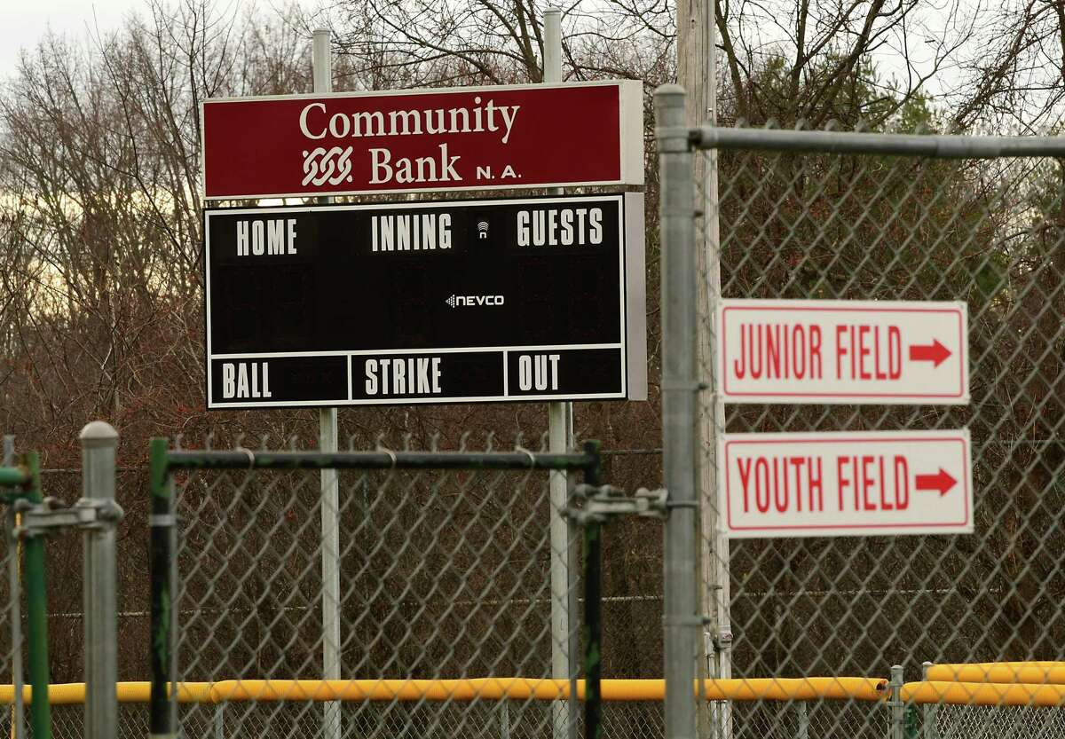 A Community Bank sponsor sign is seen on top of the scoreboard of a baseball field at the Magee Park Tri -Village Little League on Thursday, Dec. 10, 2020 in Bethlehem, N.Y. (Lori Van Buren/Times Union)