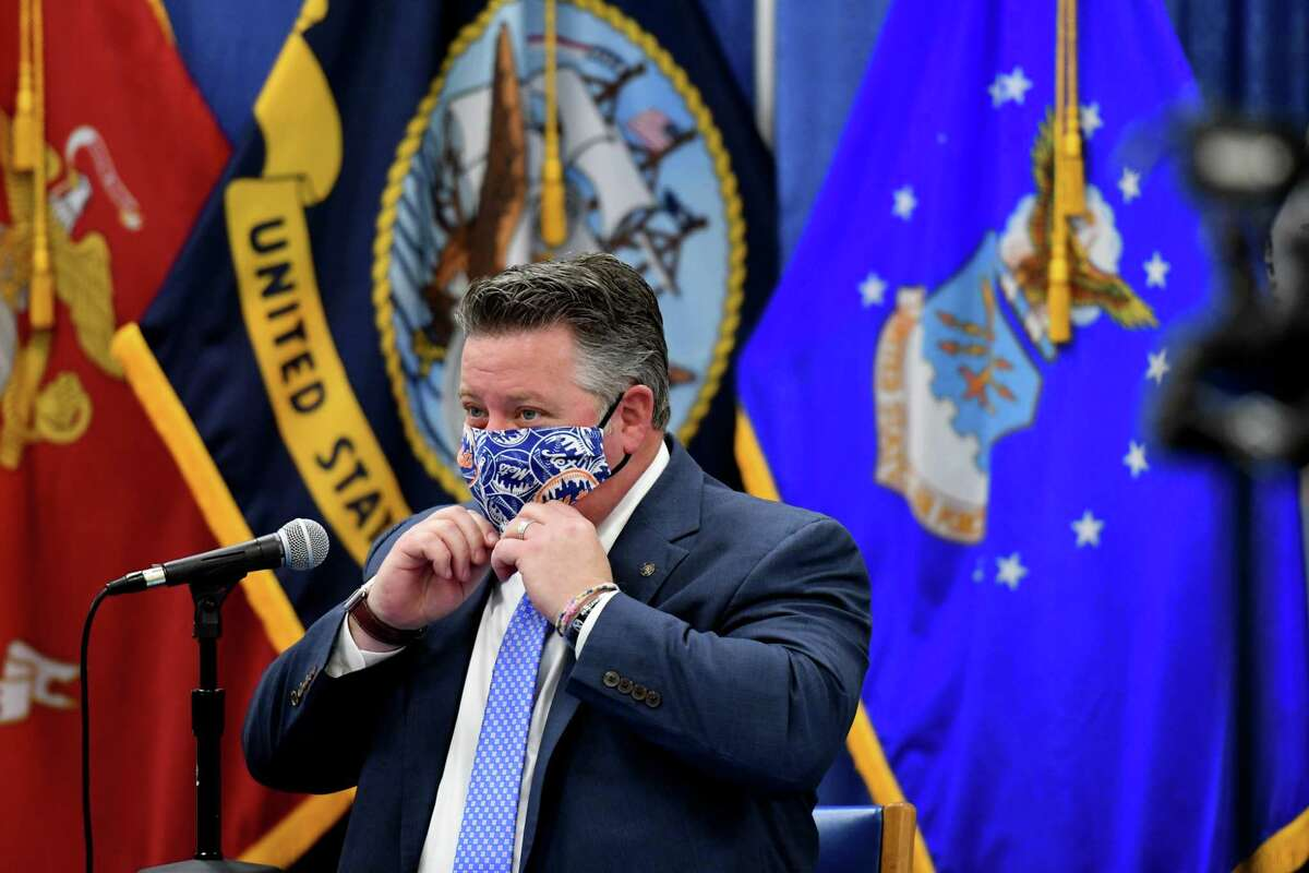 Albany County Executive Dan McCoy adjusts his face mask during a Albany County coronavirus briefing on Thursday, Dec. 10, 2020, at the county office building in Albany, N.Y. The county reported an increase of 208 new positive cases since Wednesday. Two deaths and 13 new hospitalizations were reported overnight. (Will Waldron/Times Union)