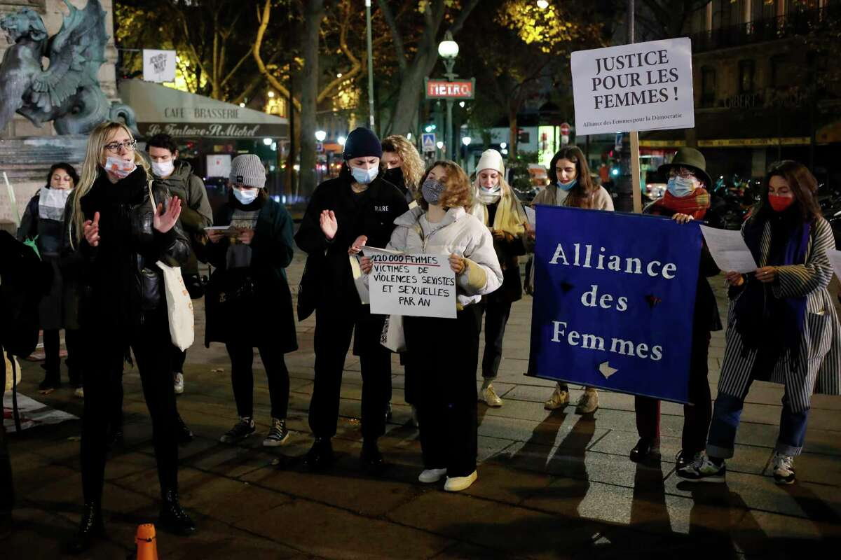 A protest in Paris last month calls for a solution to domestic violence, which is up globally, including in San Antonio, since the pandemic began.