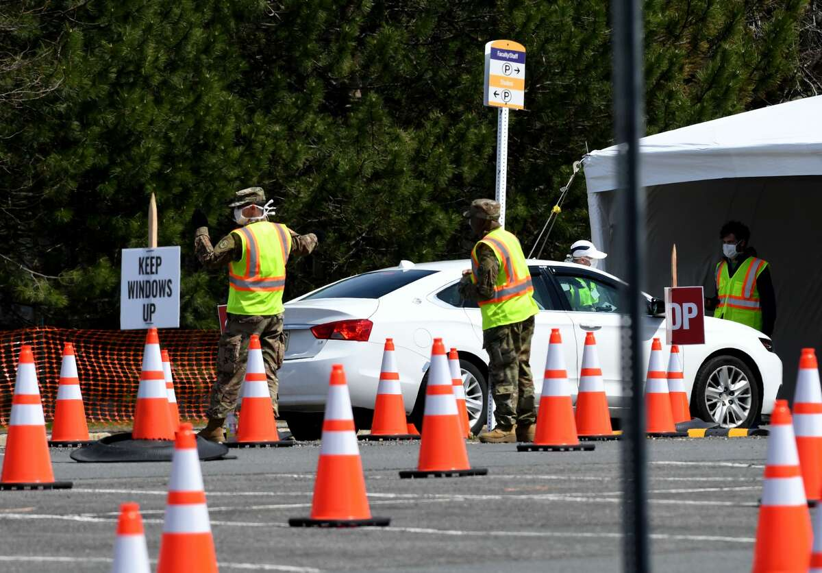 New York National Guard members usher patients through the drive-thru coronavirus testing site at the University at Albany campus on Tuesday, April 14, 2020, in Albany, N.Y. (Will Waldron/Times Union)