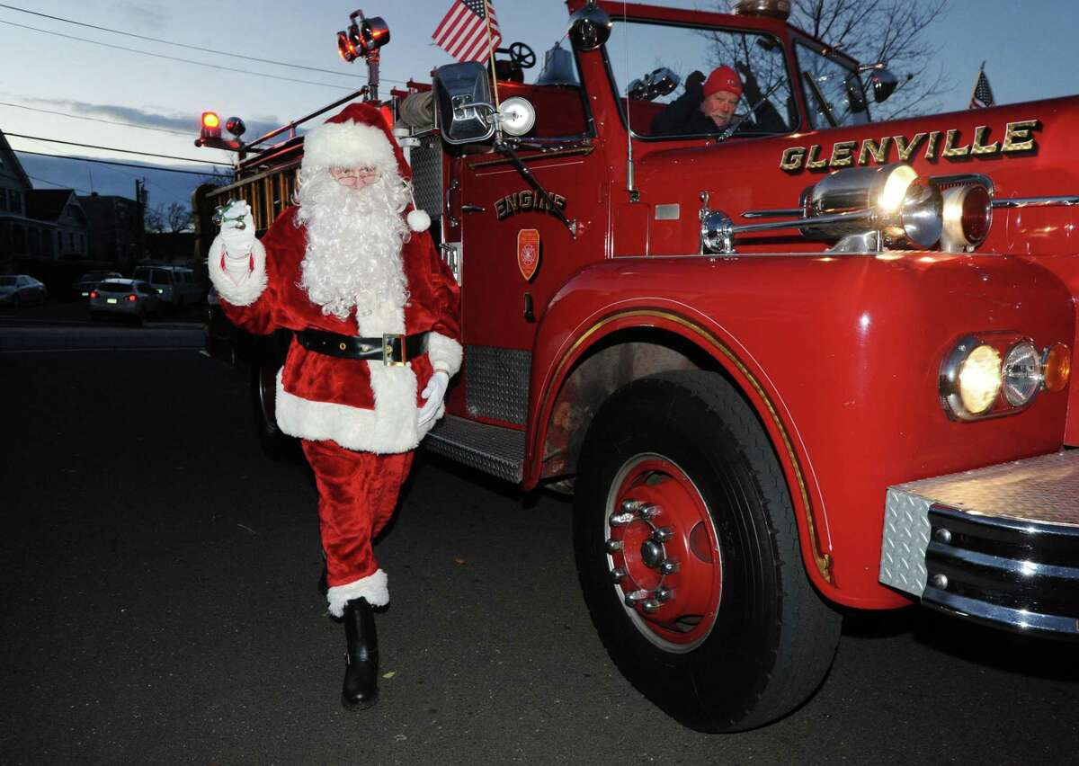 Santa arrives during the annual Christmas Tree lighting at the Byram Shubert Library in the Byram section of Greenwich, Conn., Saturday, Dec. 3, 2016.
