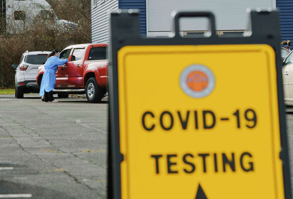 Staff with the Schenectady County Public Health Services conduct Covid testing at a parking lot at SUNY Schenectady on Thursday, Dec. 10, 2020, in Schenectady, N.Y. (Paul Buckowski/Times Union)