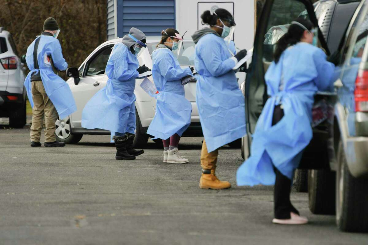 Staff with the Schenectady County Public Health Services conduct Covid-19 testing at a parking lot at SUNY Schenectady on Thursday, Dec. 10, 2020, in Schenectady, N.Y. (Paul Buckowski/Times Union)