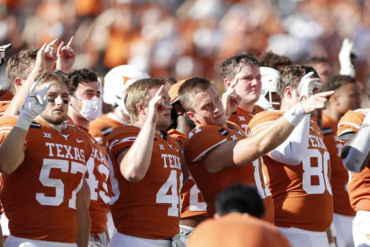 AUSTIN, TEXAS - NOVEMBER 07: The Texas Longhorns stand for The Eyes of Texas after the game against the West Virginia Mountaineers at Darrell K Royal-Texas Memorial Stadium on November 07, 2020 in Austin, Texas. (Photo by Tim Warner/Getty Images)
