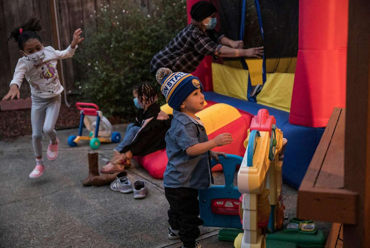 Lilliana Vallete, 5 (left), Brooklyn Johnson, 3, and Matthew Enriquez, 2, play at Wishing Well Daycare in Hayward.
