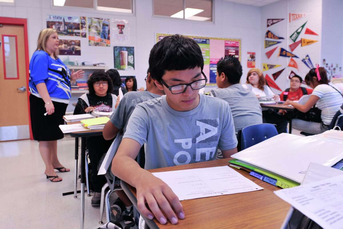 Harlandale Middle School 8th grader Ray Rodriguez looks over his notes as a teacher begins an Avid program class in this 2012 file photo. Avid is a college-ready curriculum designed to meet the standards of the STAAR Test.