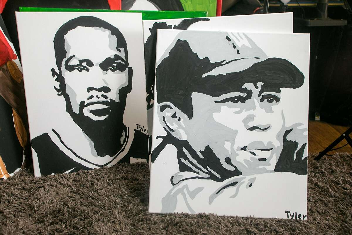 A portrait of Kevin Durant and Tiger Woods drawn by Tyler Gordon, a 14-year-old artist viewed at his home in San Jose, Calif., on Dec. 7, 2020. Tyler's portraits have gone viral recently, so much so that he has received a phone call from Kamala Harris after she saw his work. He also painted the recent cover of LeBron James for Time magazine.