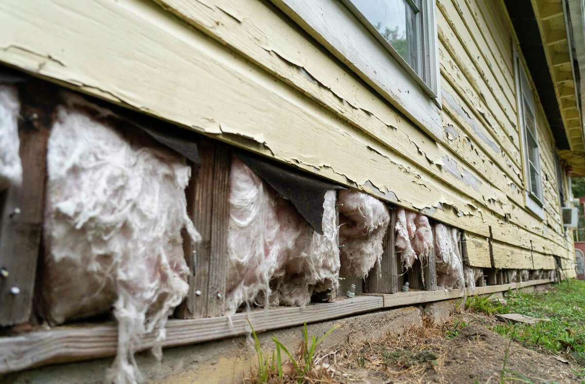 Siding has fallen off Valeria Tamez's house in southeast Houston, pictured Nov. 13, 2020, as it has shifted on its foundation. Tamez was notified by the city late last year that her application for housing relief would have to move from the city's program to one being run by the state's General Land Office.
