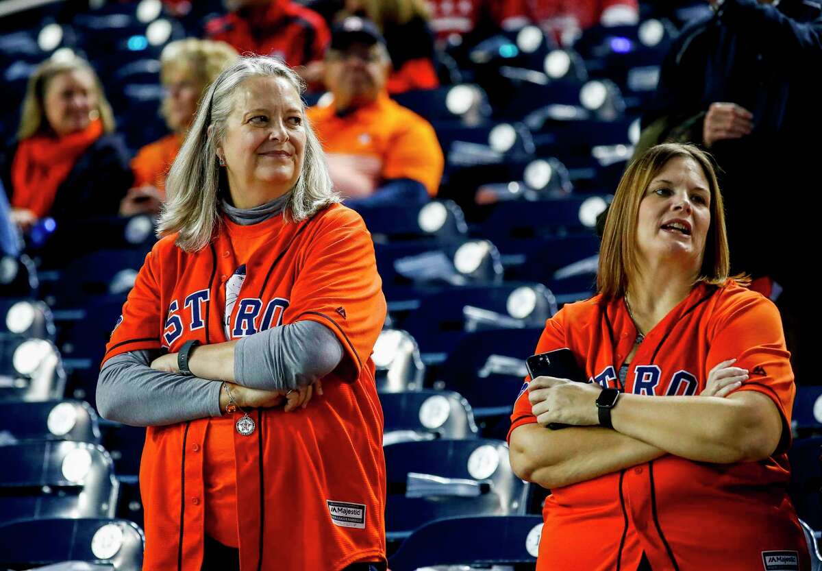 Susan Welbes (left), of Houston, watches batting practice before Game 3 of the World Series at Nationals Park in Washington, D.C. on Friday, Oct. 25, 2019.A well-known Astros fan, Welbes is leaving The Woodlands after 22 years as human resources director. Welbes said she will not only miss the township which she has helped create, but also the family atmosphere and friendly faces she hired - some dating back two decades