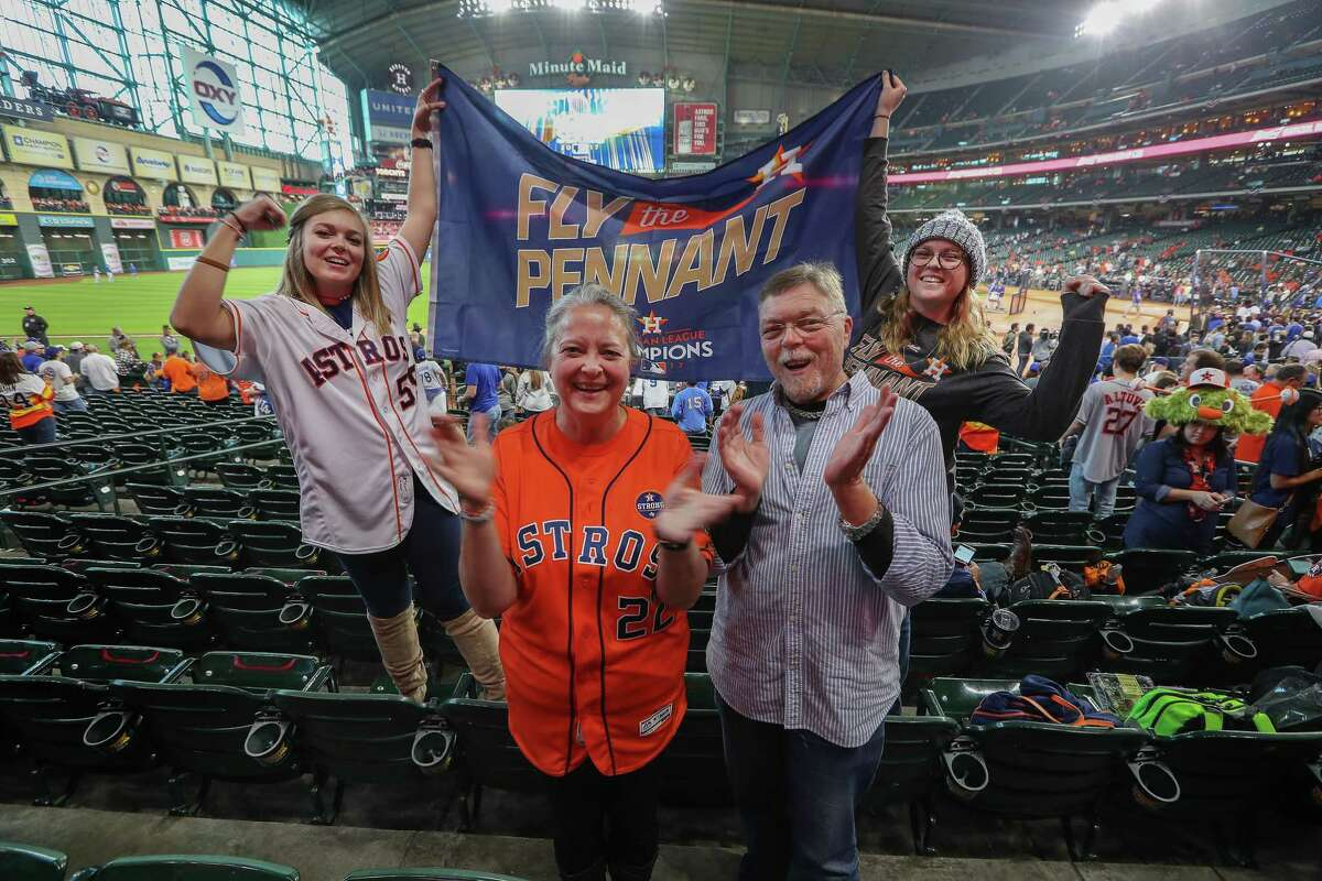 The Woodlands Township's human resources director Susan Welbes (second from left) is shown in this 2017 photograph with her husband Mike, daughters arah (left) and Rachel hope for a Astros win during the World Series Game 5 Sunday, Oct. 29, 2017, in Houston. Now, after 22 years of recruiting, reviewing resumes and vetting candidates for the township, the face applicants first see in their orientation is bidding adieu to the staff she helped build. On Dec. 16, Welbes will say goodbye on her last day of work before beginning a new career with Travis County. (Steve Gonzales / Houston Chronicle )