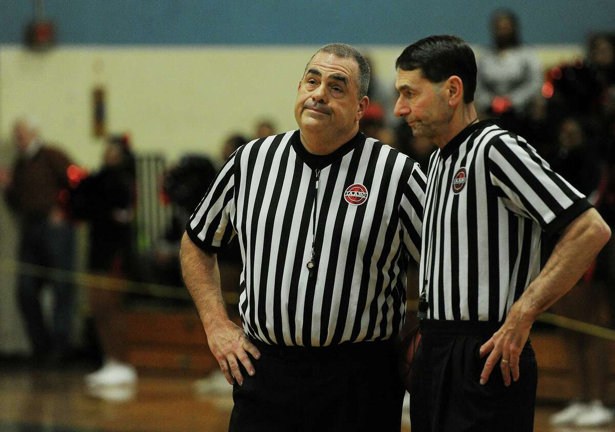 Basketball officials Tom Sportini, left, and Craig Zysk at a Harding-Bridgeport Central boys game at Harding High School on Feb. 22, 2018.