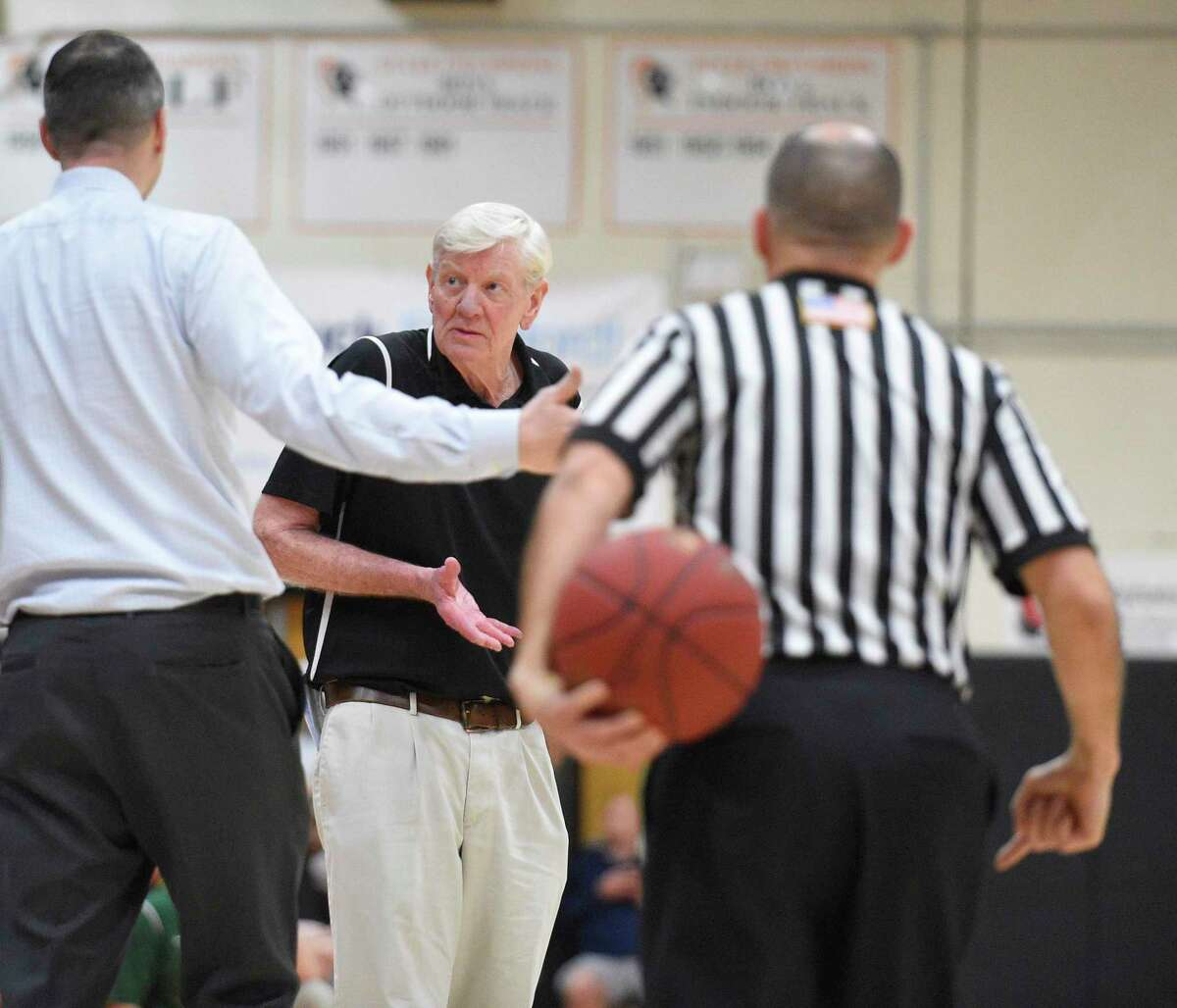 Stamford coach Danny Melzer, left, and Trinity Catholic coach Mike Walsh react to an official's call in a game in February 2018.