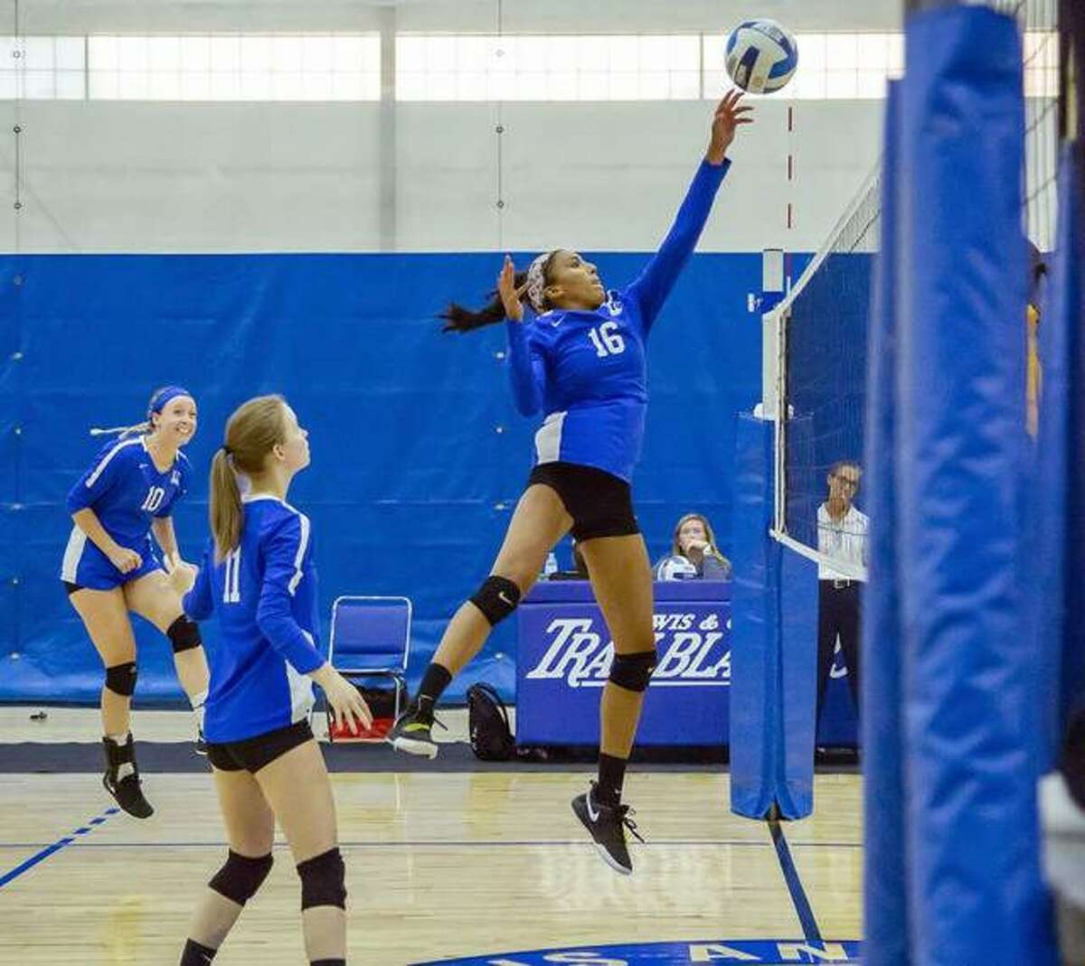 Tiana Wiseman of LCCC (16) reaches high for the ball last season against Frontier Community College. Also pictured are the Trailblazers' Brittney Alexander (10) and Sydney Bates (11).