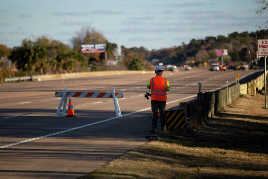 """A man watches as emergency personnel work near a gas leak located near the intersection of Texas 105 and South Pine Lake Road, Thursday, Dec. 10, 2020, in Conroe. The police and firefighters on the scene described the leak as """"major"""" while closing roads near the leak for up to 8 hours. Photo: Gustavo Huerta, Houston Chronicle / Staff Photographer / 2020 © Houston Chronicle"""