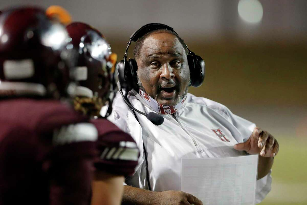 Heights Bulldogs head coach Stephen Dixon Sr. talks with his players during the first half of a high school football game against the Lamar Texans at Delmar Stadium Friday, Nov. 13, 2020 in Houston, TX.