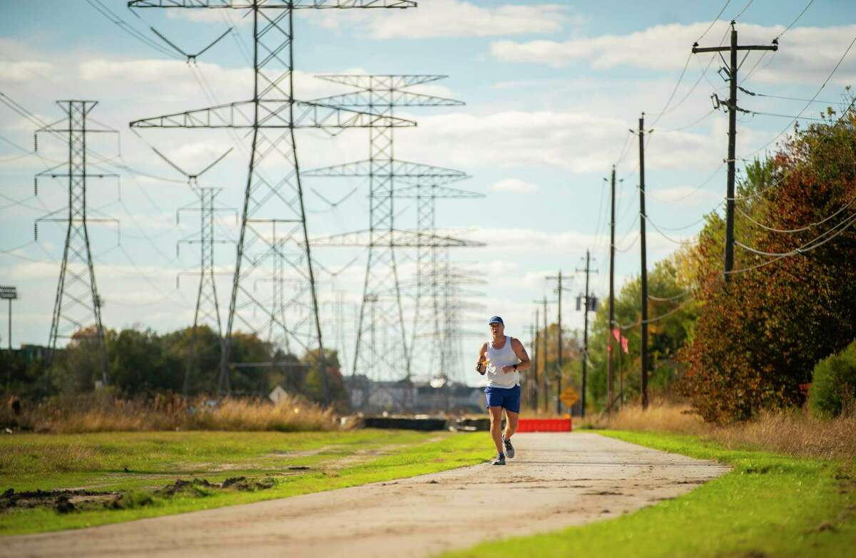 Wade Bainum, 49, jogs down the first phase of a trail that runs from Wirt Road to Blalock Road in Spring Branch on Dec. 10, 2020, in Houston. Local officials are planning a trail that will extend from Addicks Reservoir to White Oak Bayou when completed.
