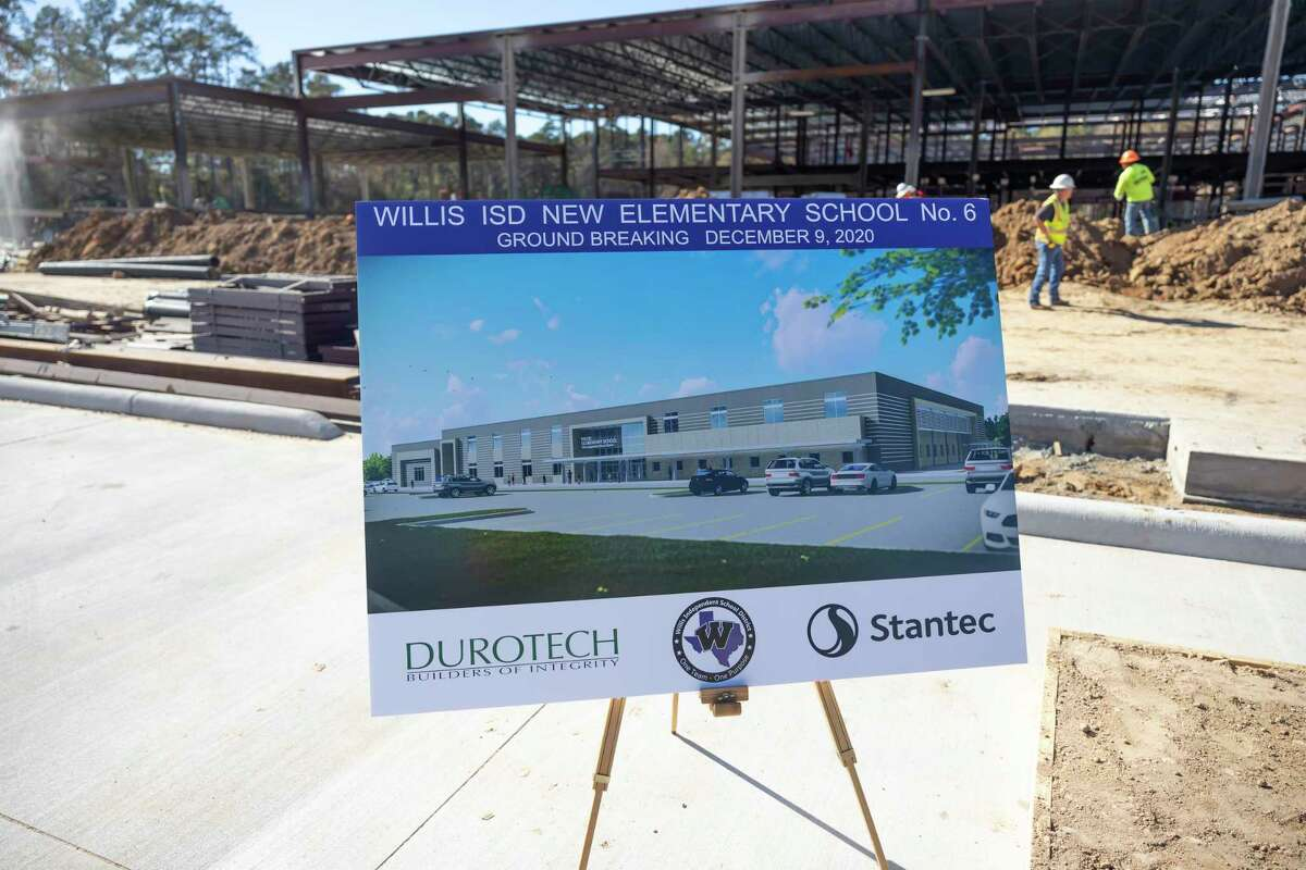 An image of Willis ISD's new elementary school is placed near construction of the school site near Longmire Road, Dec. 9, 2020, in Willis. The two-story campus is expected to house 850 kindergarten through fifth grade students and will be the sixth elementary school in the district.