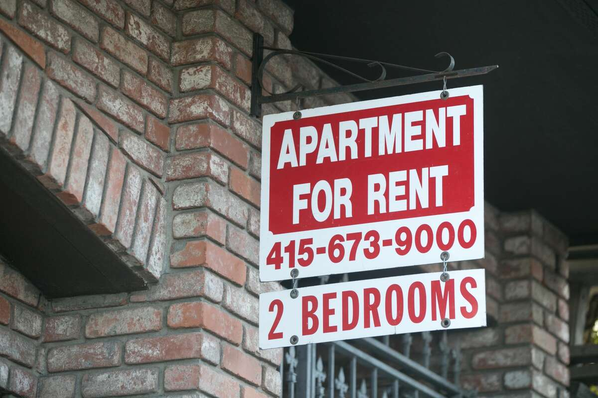 A for rent sign hangs outside an apartment building in San Francisco on Dec. 8, 2020.