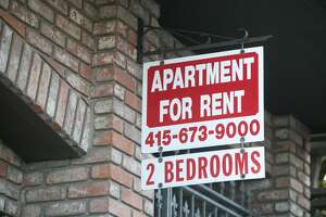 A for rent sign hangs outside an apartment building in San Francisco, California on Dec. 8, 2020.