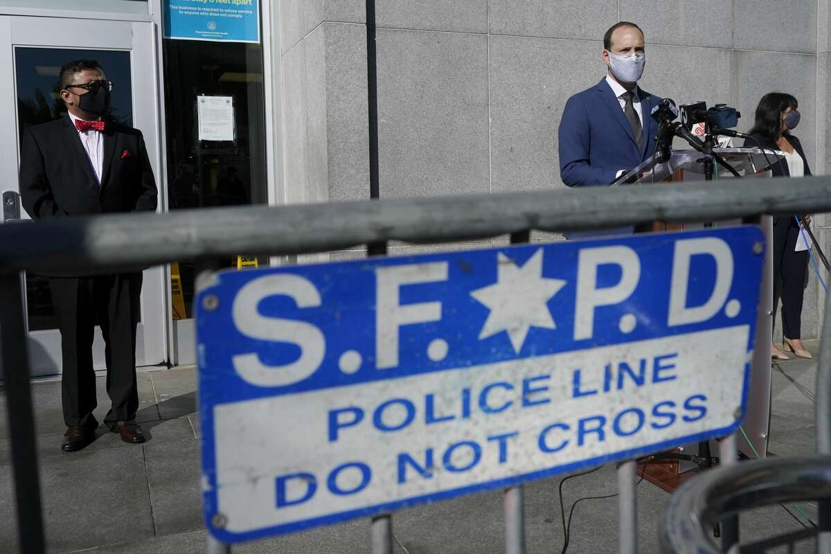 San Francisco District Attorney Chesa Boudin, foreground right, speaks between the chief of staff David Campos, left, and assistant district attorney Rachel Marshall at a news conference in San Francisco, Monday, Nov. 23, 2020.
