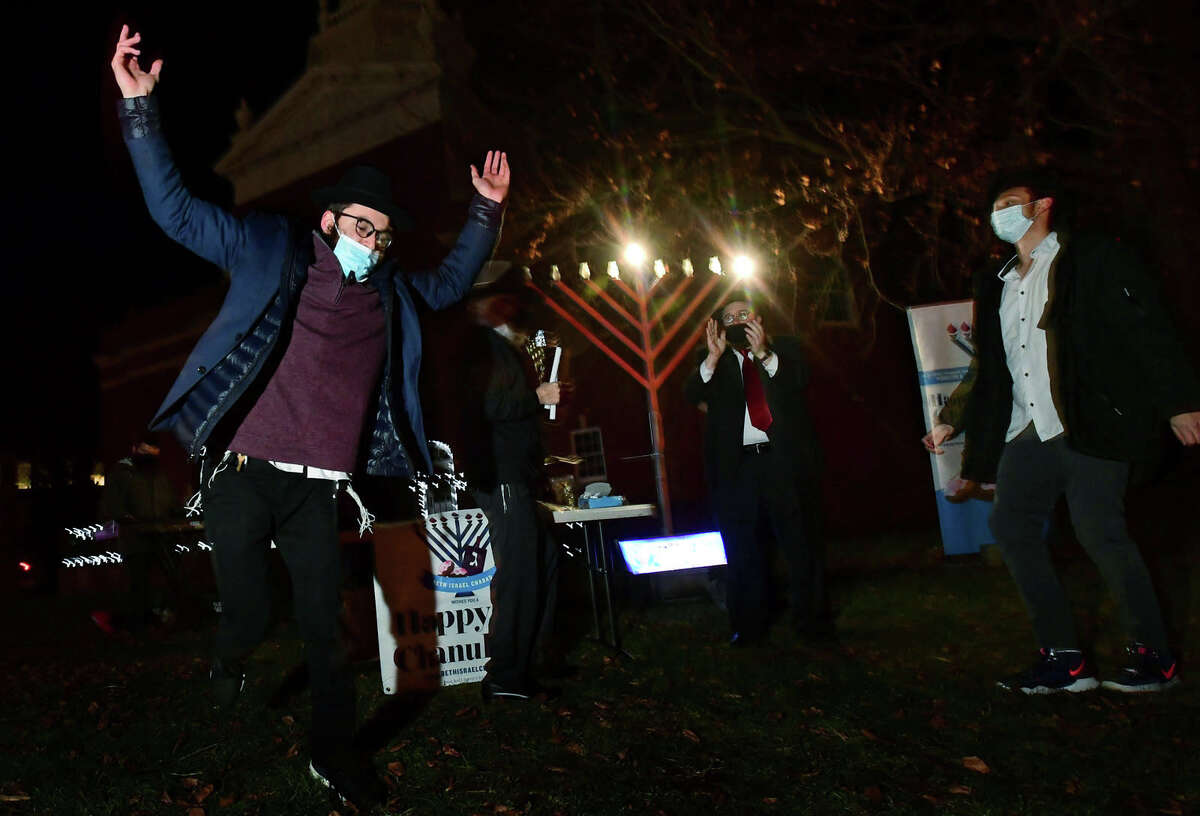 Students from the New England Rabbinical College dance during a celebration of the start of Hanukkah, the eight-day Jewish Festival of Lights, on the front lawn of City Hall in Norwalk.