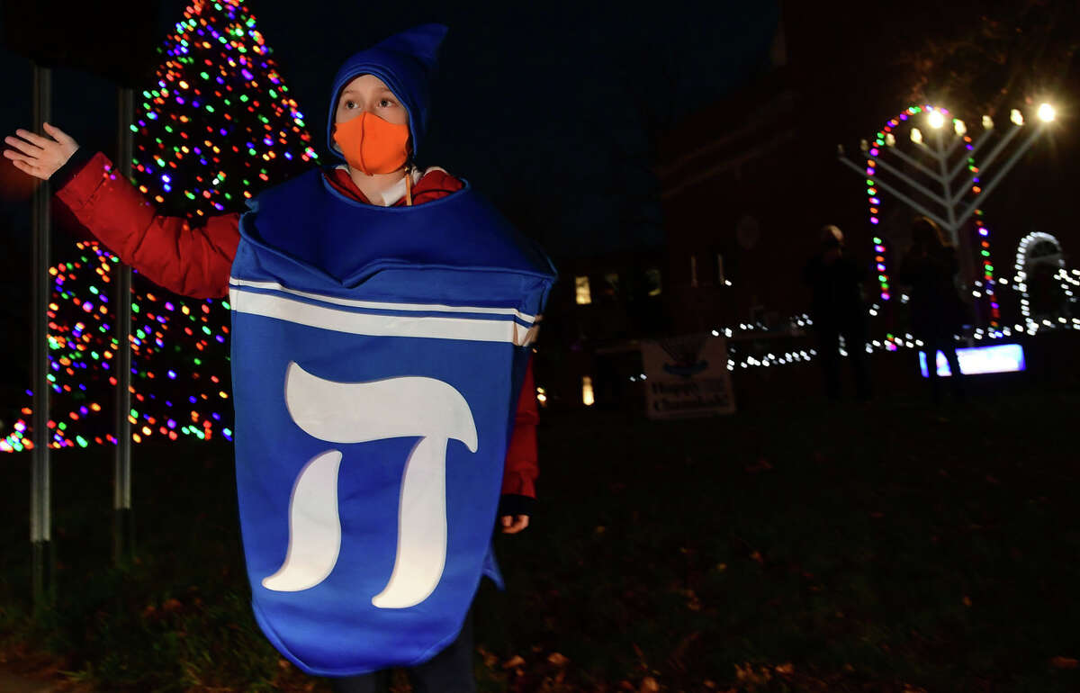Eli Stone, 9, wore a dreidel costume to a celebration of the start of Hanukkah, the eight-day Jewish Festival of Lights, on the front lawn of City Hall in Norwalk on Thursday, December 10, 2020.