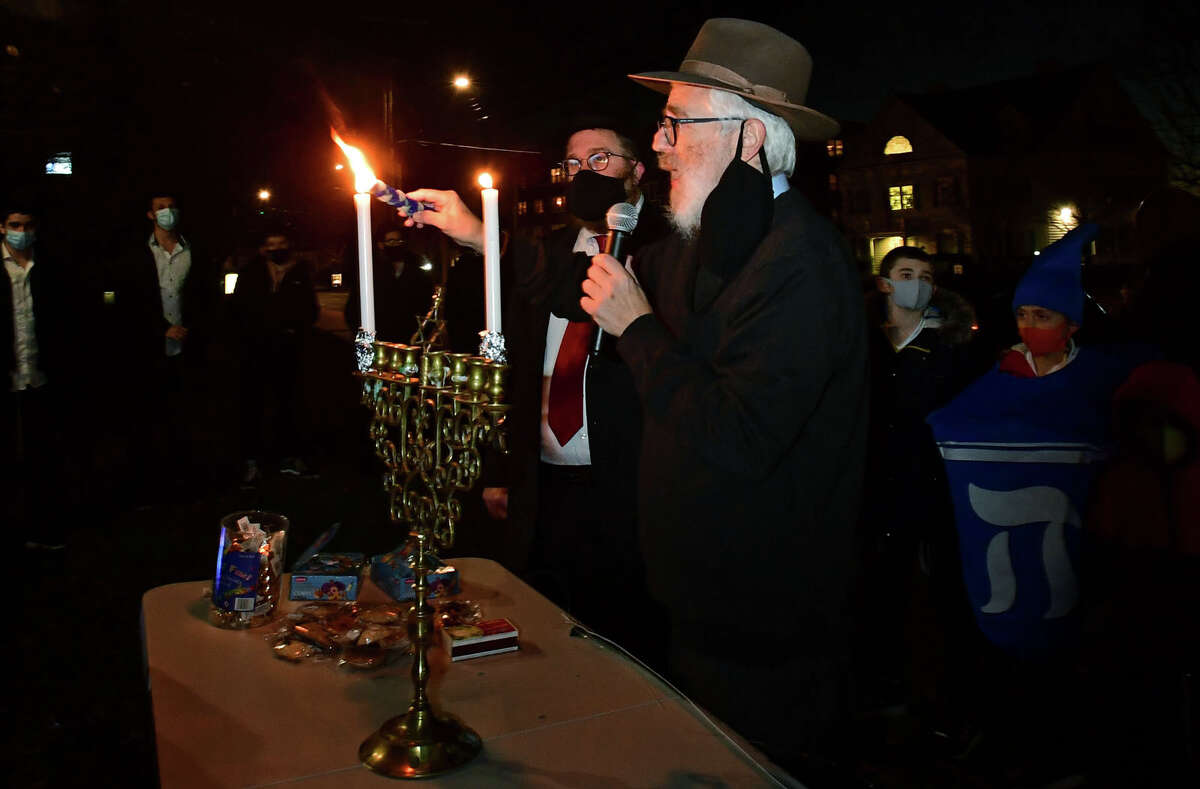 Rabbi Yehoshua S. Hecht, Beth Israel, and Rabbi Levi Stone, Schneerson Center for Jewish Life hold a menorah lighting ceremony Thursday, December 10, 2020, marking the first light of the eight-day Chanukah festival on the front lawn of City Hall in Norwalk, Conn. The first day of Hanukkah marks the start of Hanukkah, also known as Chanukah or Festival of Lights. Hanukkah is an eight-day Jewish observance that remembers the Jewish people's struggle for religious freedom.