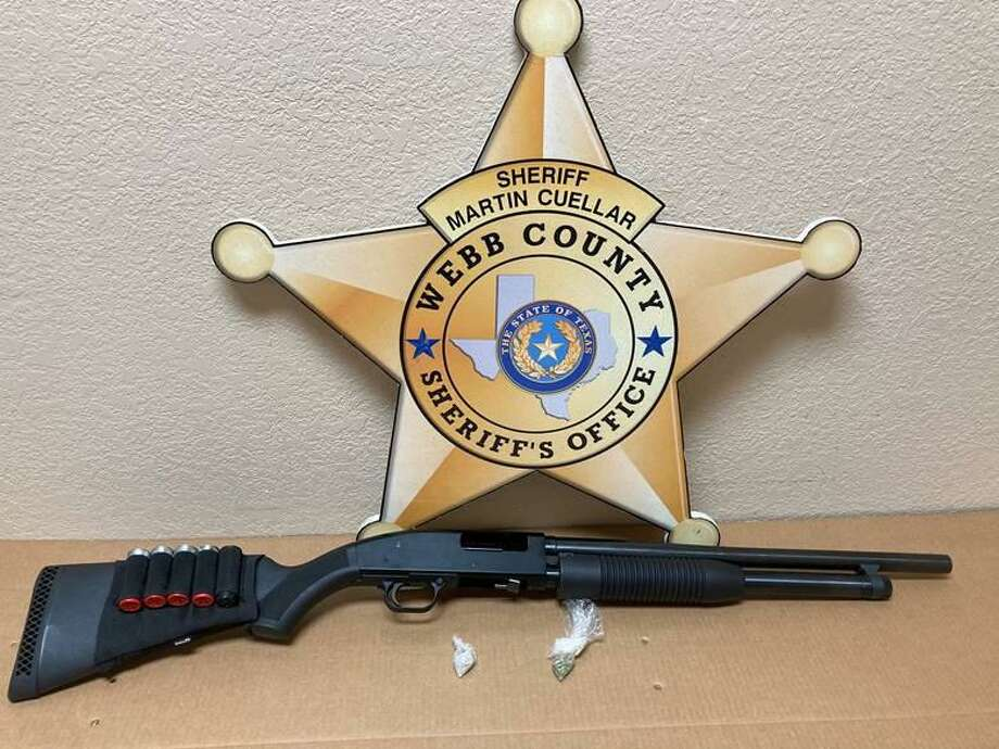 The Webb County Sheriff's Office said they seized 2 grams of powder heroin and a shotgun after executing a narcotics search warrant at a home in the 500 block of Rio Amur Road in the City of Rio Bravo. Photo: Courtesy Photo /Webb County Sheriff's Office