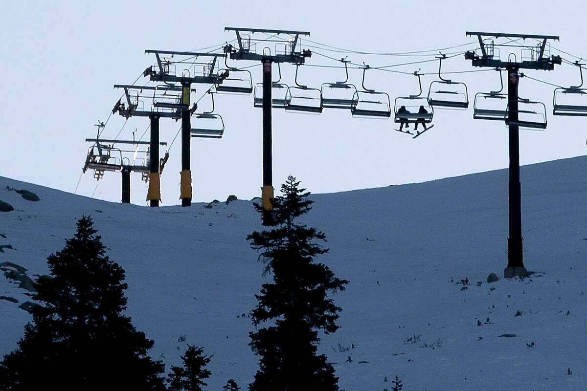 Snowboarders ride the ski lift to the top of Heavenly Mountain in South Lake Tahoe.