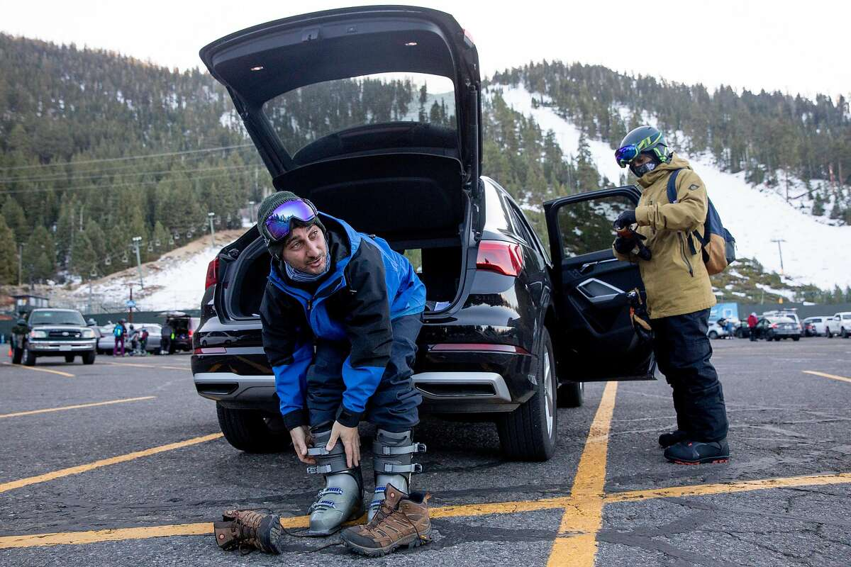 Mike Ernst (left) and Justin Suveg of New Jersey gear up to ski and snowboard at Heavenly Mountain Resort in South Lake Tahoe, December 10, 2020.