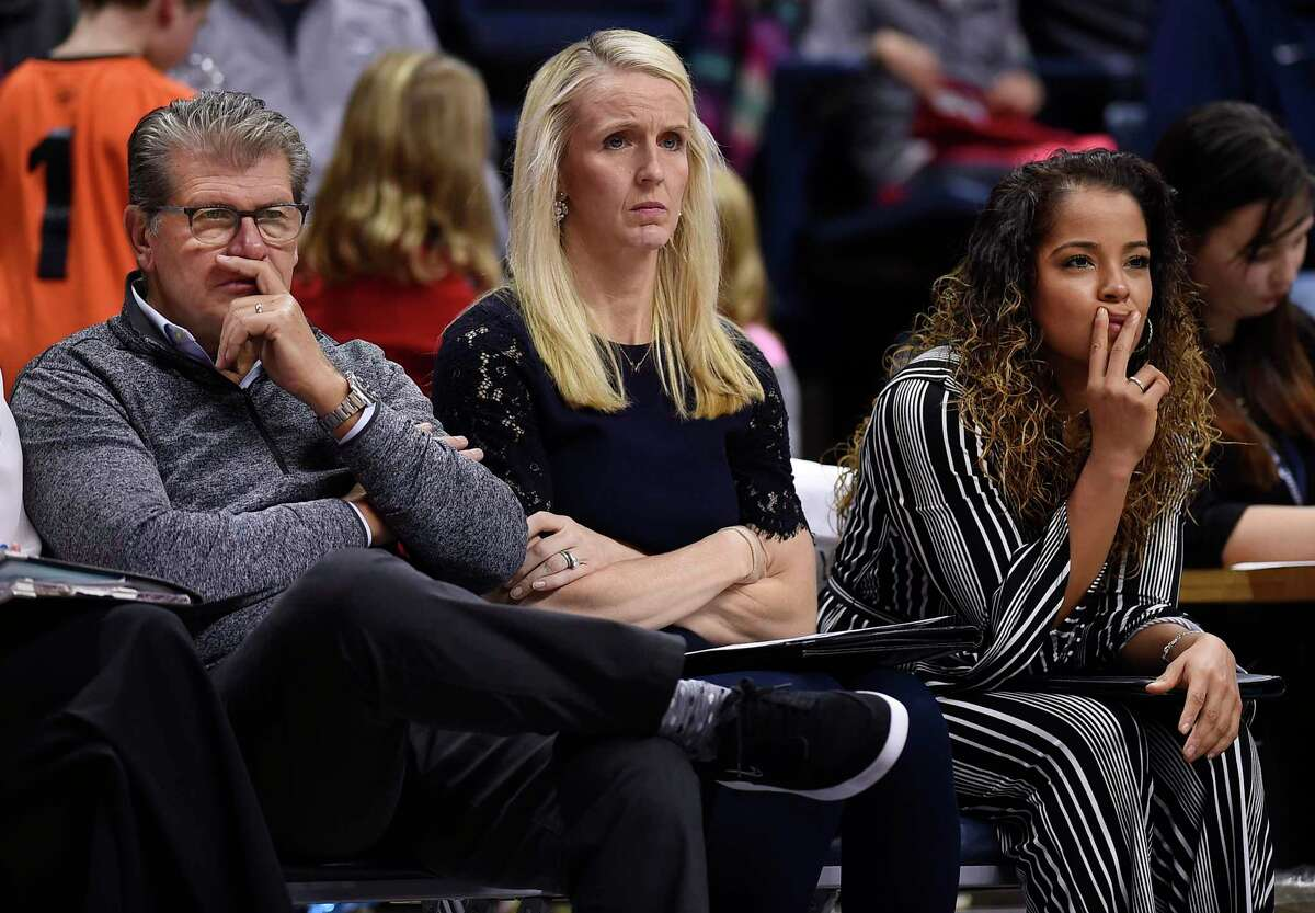 Connecticut head coach Geno Auriemma, left, watches play with assistant coaches Shea Ralph, center, and Jasmine Lister, right, during the second half of an NCAA exhibition women's college basketball game against Vanguard in Storrs, Conn., Sunday, Nov. 4, 2018. (AP Photo/Jessica Hill)