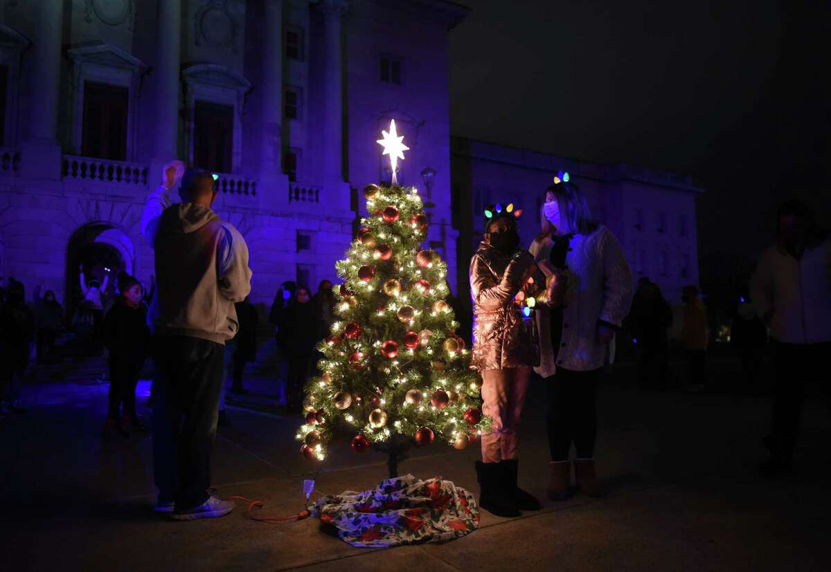Maliha Jackson, 14, stands next a a special Christmas tree, lit just for her, during a surprise tree lighting ceremony on Thursday, Dec. 10, 2020, at Hackett Middle School in Albany, N.Y. (Will Waldron/Times Union)