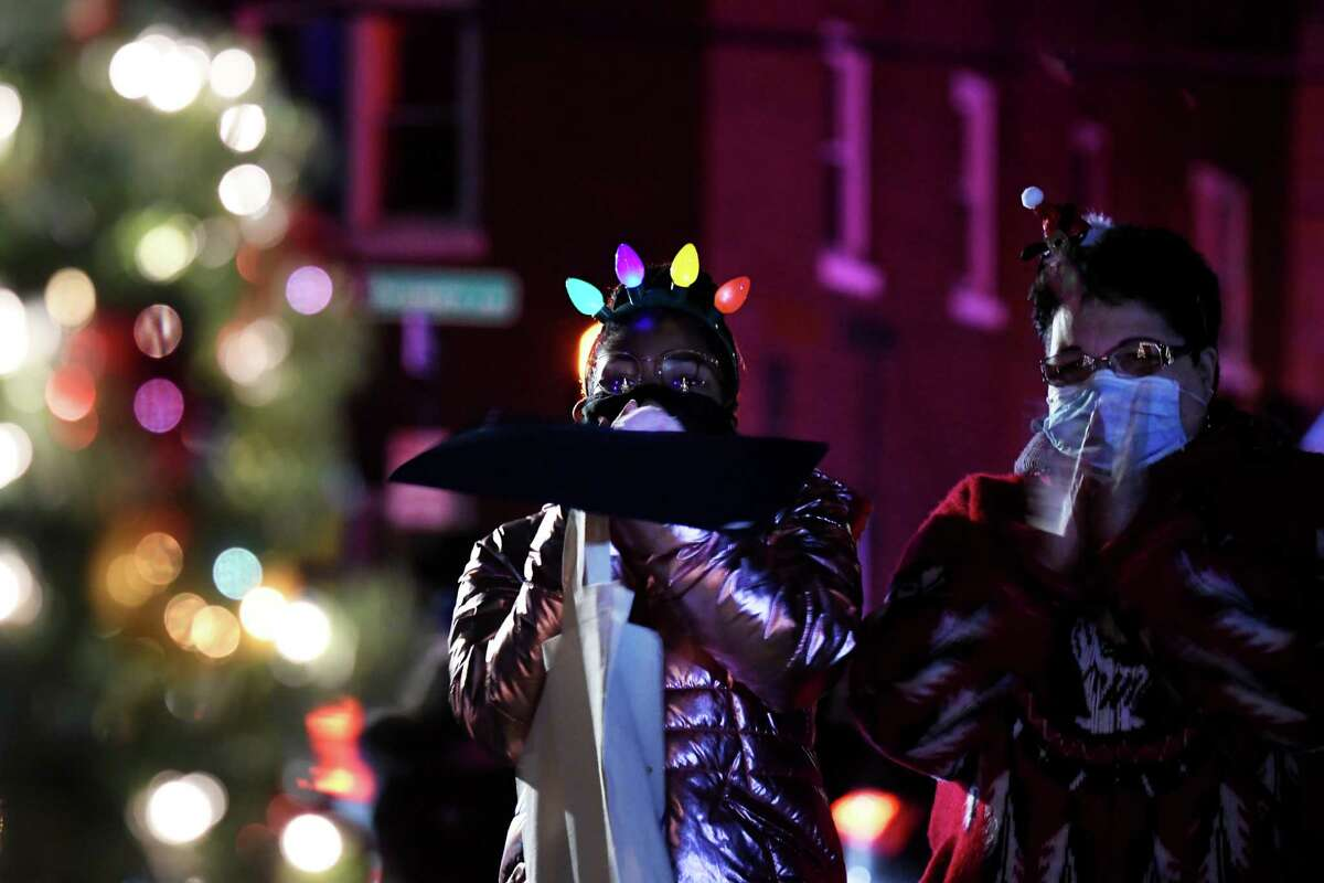 Maliha Jackson, 14, is elated by the lights of a Christmas tree lit in her honor during a surprise lighting ceremony on Thursday, Dec. 10, 2020, at Hackett Middle School in Albany, N.Y. (Will Waldron/Times Union)