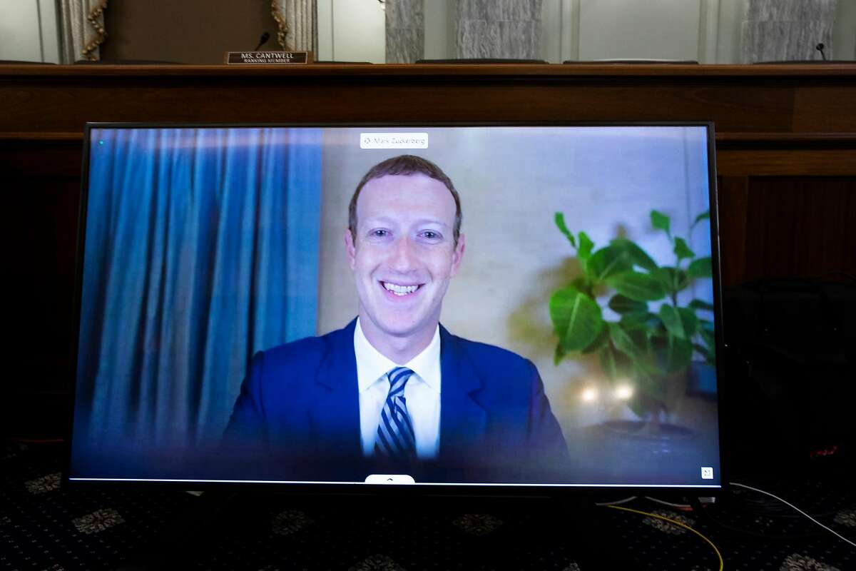 Facebook CEO Mark Zuckerberg, shown here during remote testimony to a U.S. Senate committee in October, said he plans to get the coronavirus vaccine but does not expect to mandate it for Facebook employees.
