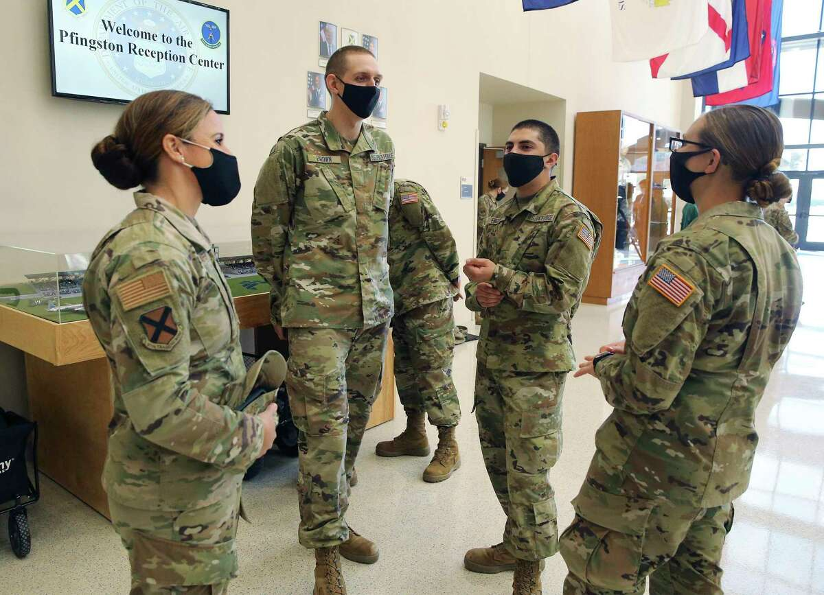 Newly graduated enlistees, among the first new recruits assigned to the U.S. Space Force, relax after graduating from basic training Thursday at Joint Base San Antonio-Lackland.