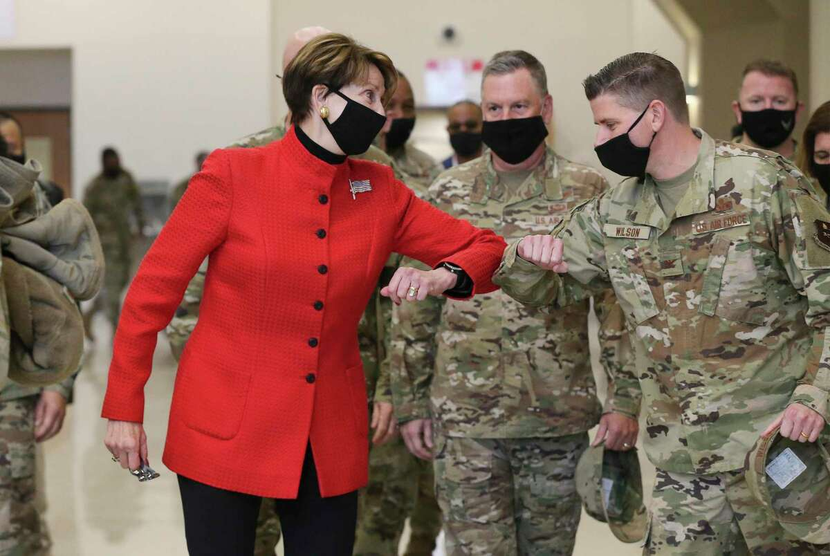 Secretary of the Air Force Barbara M. Barrett (center) offers an elbow greeting as the first seven trainees to enlist directly into the U.S. Space Force graduate from basic training Thursday at Joint Base San Antonio-Lackland.