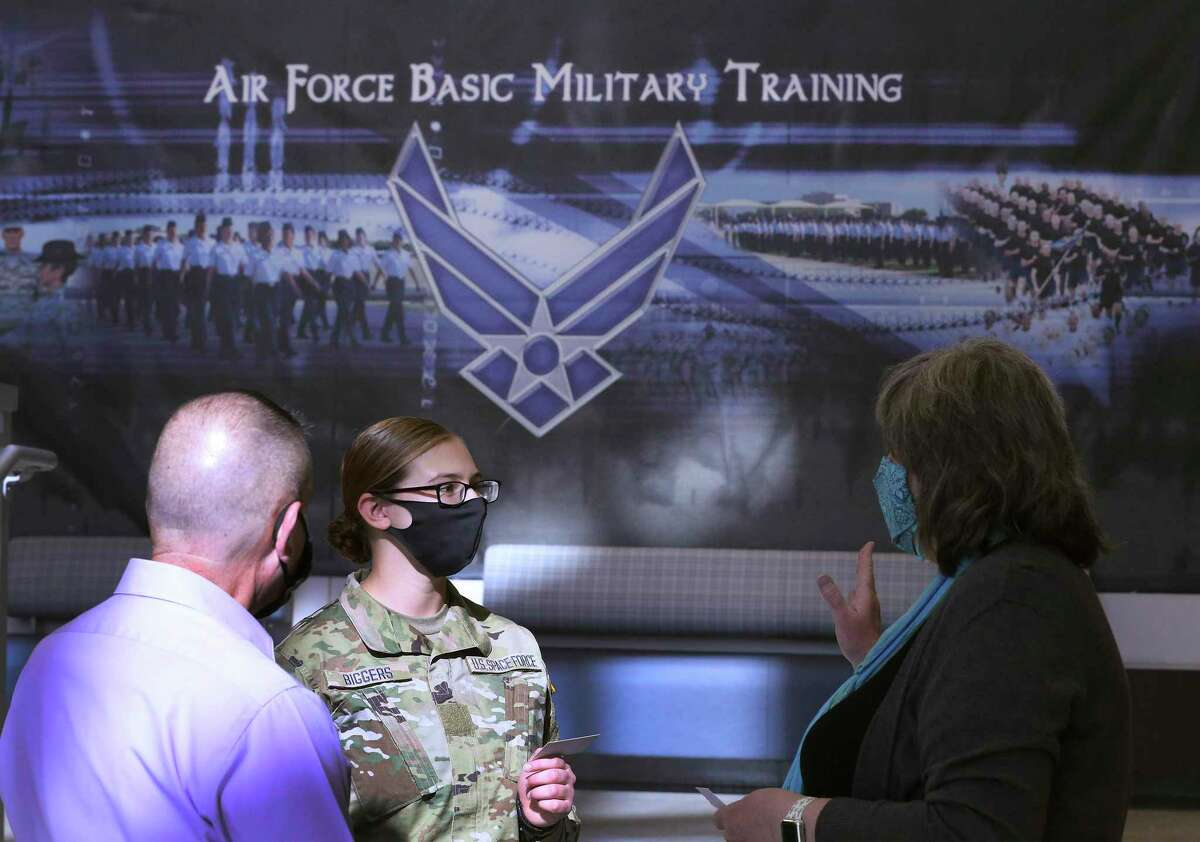Amy Biggers (center) chats with officials after she and six other trainees, the first assigned to the U.S. Space Force, graduate from Air Force basic training Thursday at Joint Base San Antonio-Lackland with 407 other recruits. For the next several months, the seven Space Force enlistees will continue with their training specific to Space Force.
