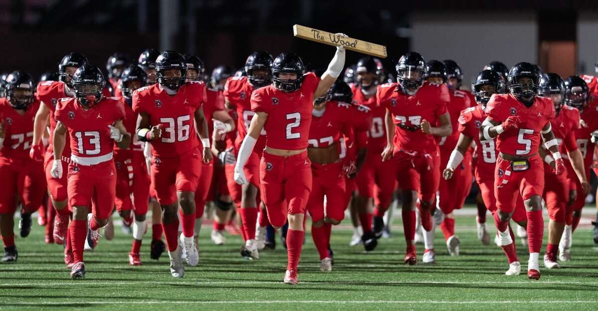 Jeremy Kolakowski (2) of the Dawson Eagles brings his team onto the field against the Dickinson Gators during a High School bi-district playoff football game on Thursday, December 10, 2020 at Pearland ISD Stadium in Pearland, Texas.