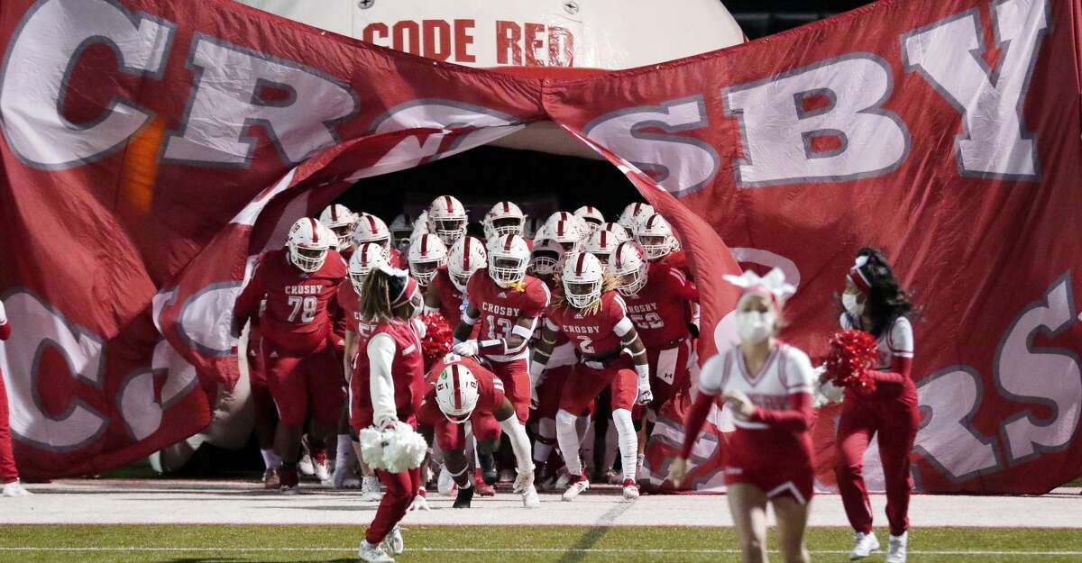 Crosby takes the field before the start of a high school football game against Nederland at Cougar Stadium Friday, Dec. 4, 2020 in Crosby, TX.