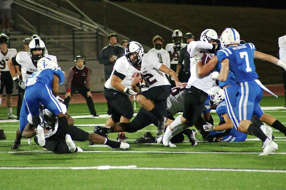 Pearland's Jake Sock (12) scrambles for yardage against Clear Springs Thursday, Dec. 10 at Challenger Columbia Stadium.